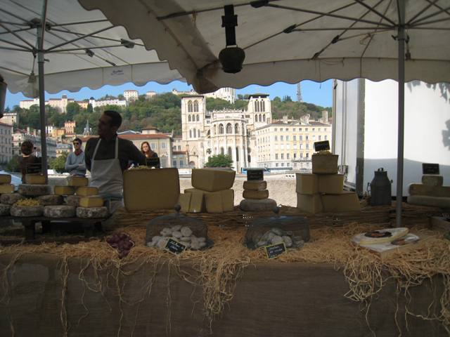 Market on the Soane River.  Fromage with Cathedrale Saint Jean in the background.